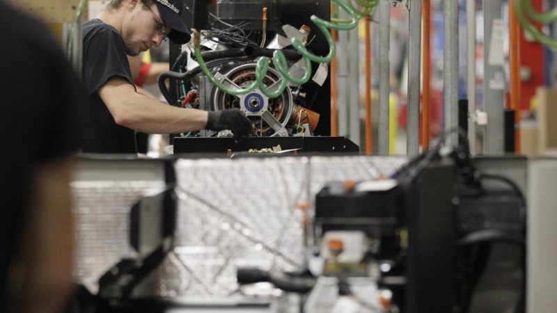 Employee on assembly line in Whitewater, Wis.
