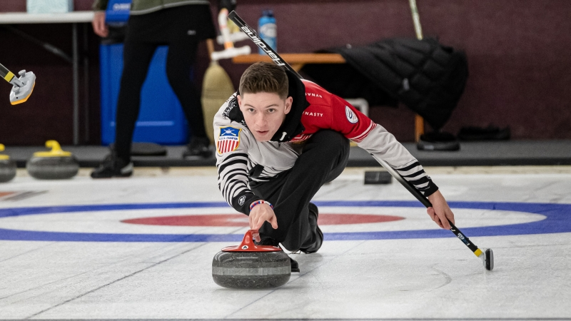 Charlie Thompson of Eau Claire practices curling.