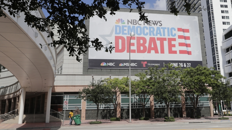 A billboard advertises the first Democratic presidential debate