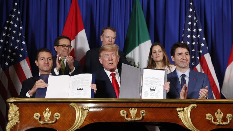 President Donald Trump, Canada's Prime Minister Justin Trudeau, right, and Mexico's President Enrique Pena Neto