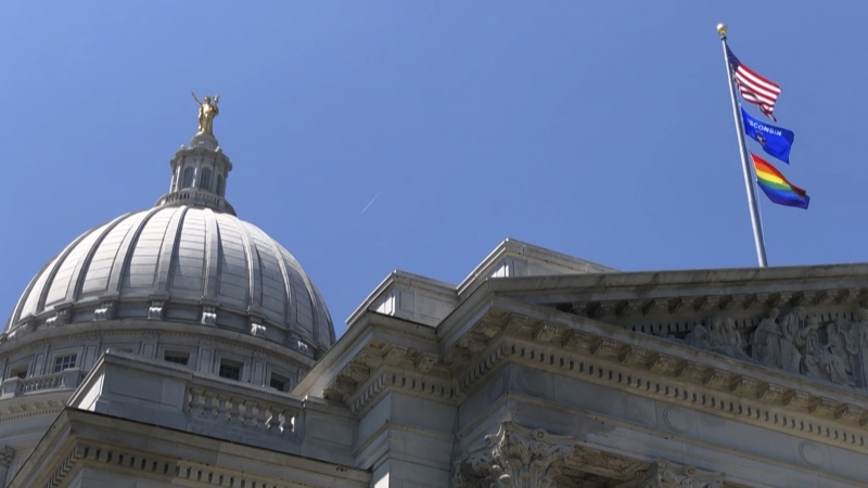 Gay pride flag over Wisconsin capitol building