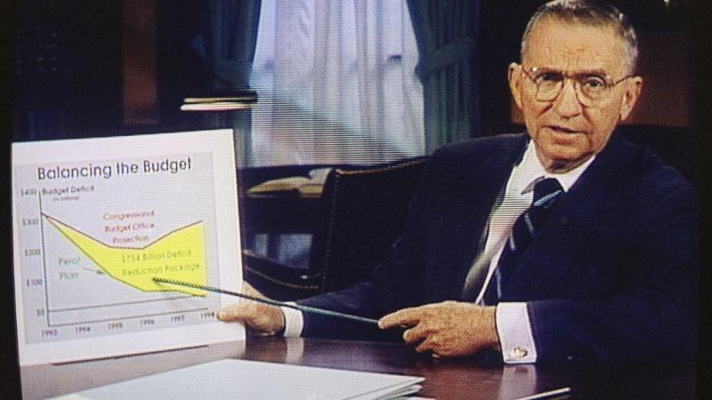 In this Oct. 16, 1992, file photo, Ross Perot is shown on a screen in a paid 30-minute television commercial, during a media preview in Dallas.