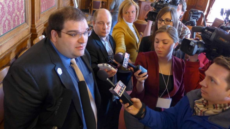 File photo of news reporters interviewing Andre Jacque
