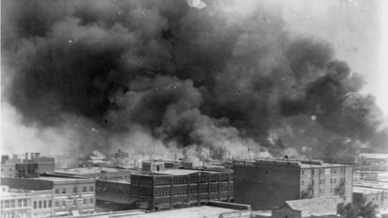 Smoke billows over Tulsa, Okla. after the Tulsa Race Massacre