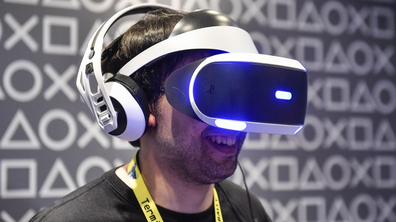 A man tests a Sony PlayStation Virtual Reality headset.