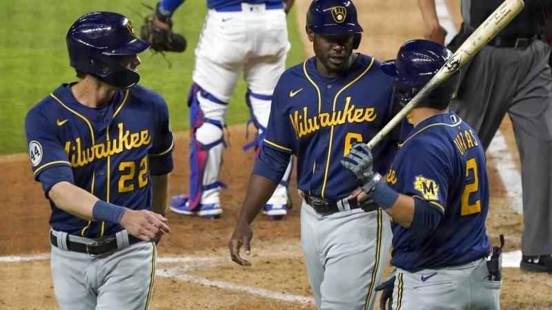 Christian Yelich, Lorenzo Cain and Luis Urias of the Milwaukee Brewers