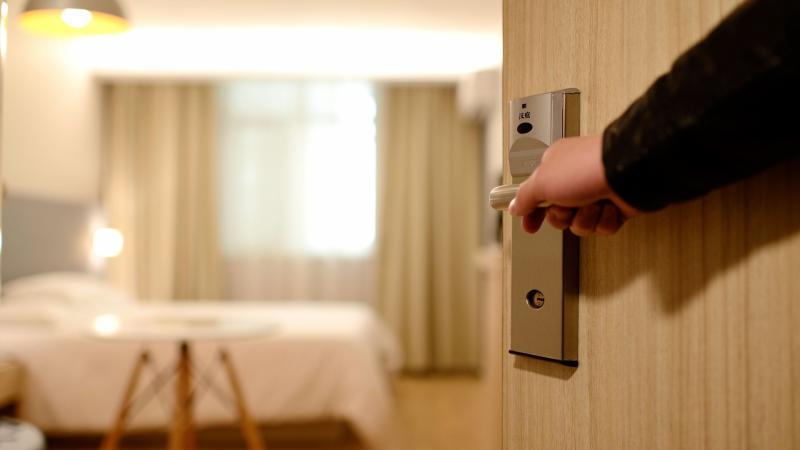 opening door to hotel room