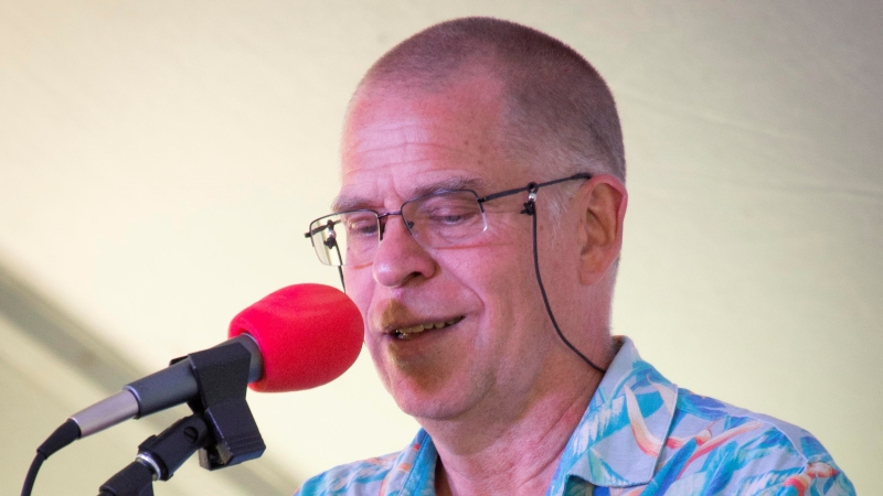 Kevin McMullin speaking into a microphone