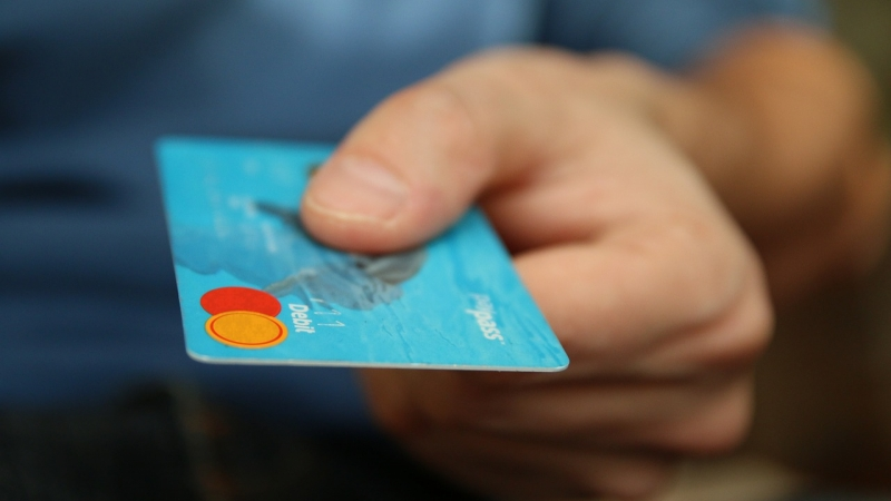 a person holds a credit card