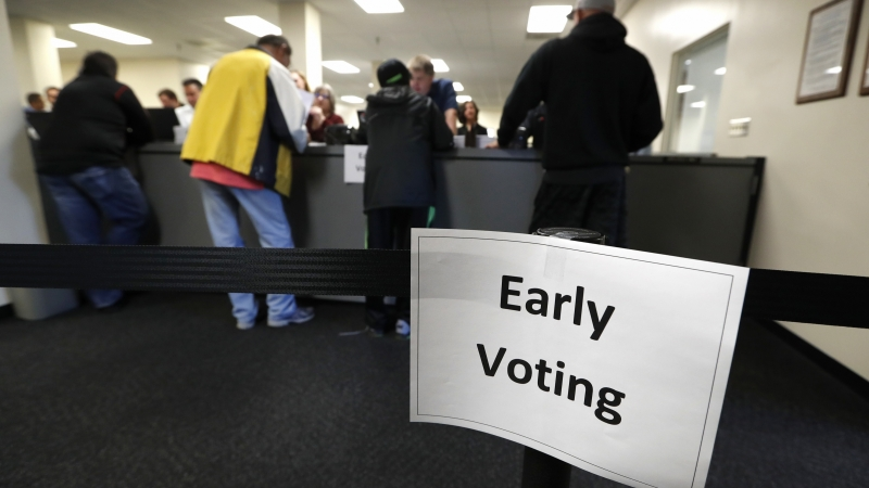 People at counter voting early