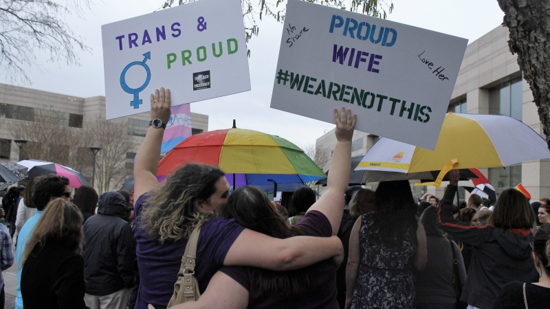 People march in support of transgender rights at a North Carolina rally.