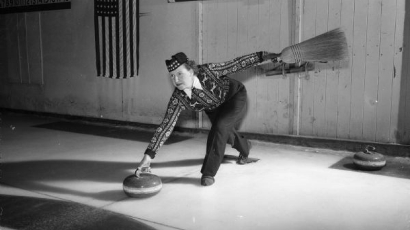 Woman releases curling stone