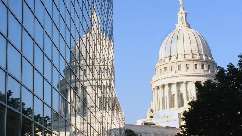 The Wisconsin Capitol reflected in an office window