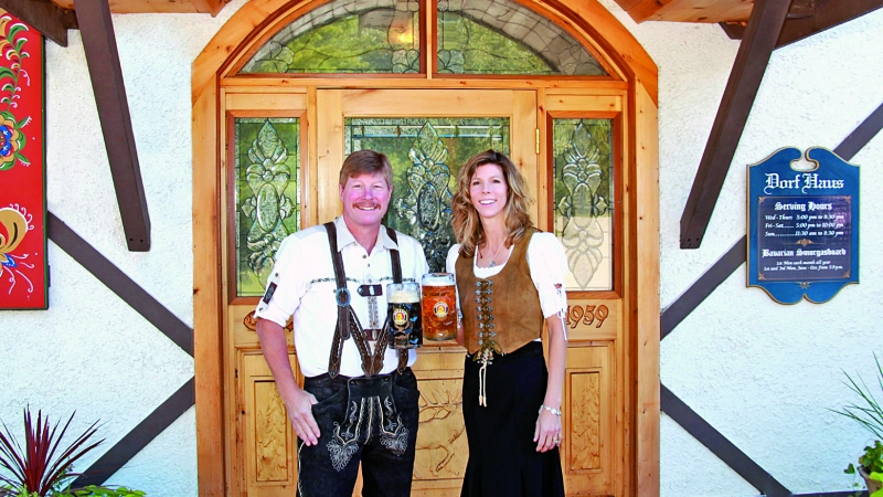 Restaurant owners in traditional German clothing