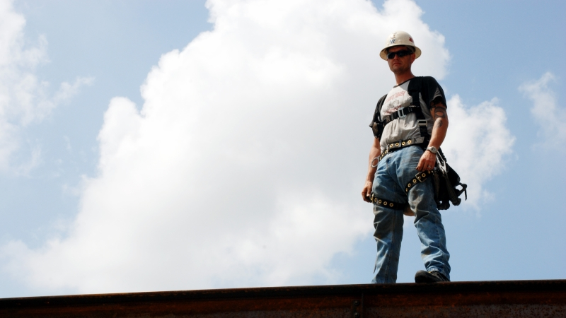 Man standing on a steel beam