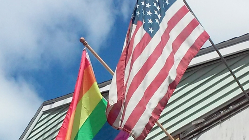 American and LGBT flags