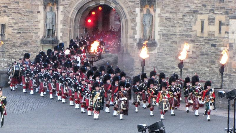 A procession of pipes and drums
