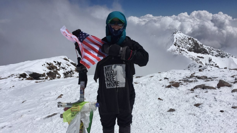 Chelsey Berg at the summit of Mount Aconcagua