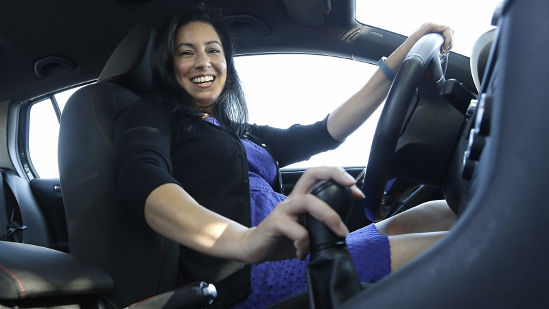 woman driving car with manual transmission