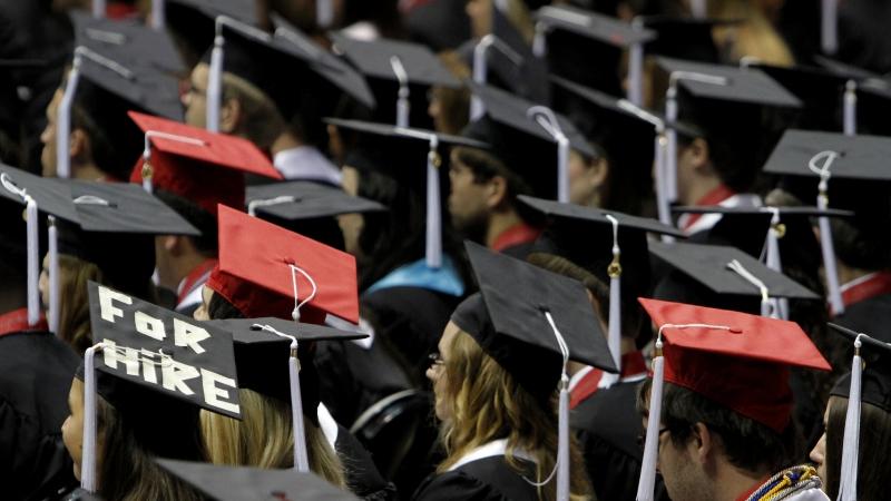 """Graduation cap says """"for hire"""""""