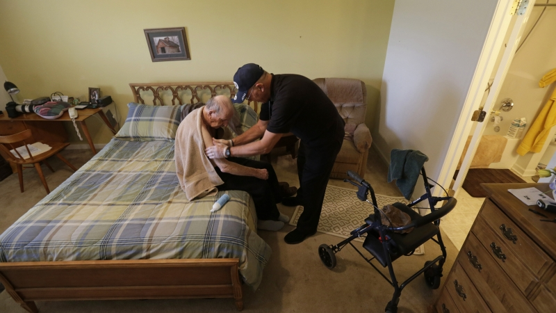 Caregiver helping a man with Alzheimer's