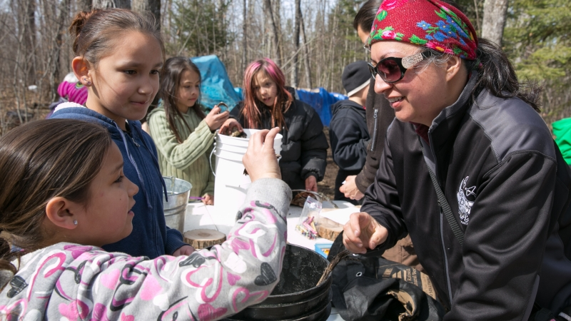 students collecting maple sugar