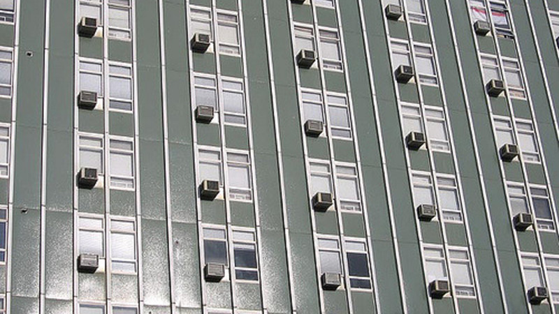 Air-conditioning units in windows on a building