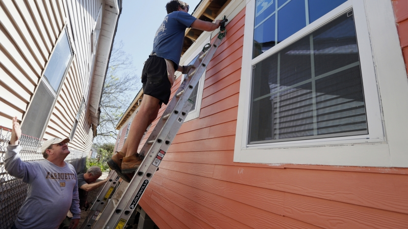 People work on a Habitat for Humanity home
