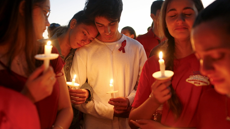 Students gather during a vigil for the victims of the Feb. 14shooting in Parkland, Fla.