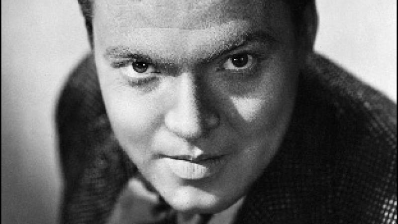 Photo of Orson Welles, host for radio program The Black Museum