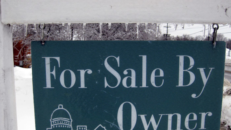 Home for sale sign in winter