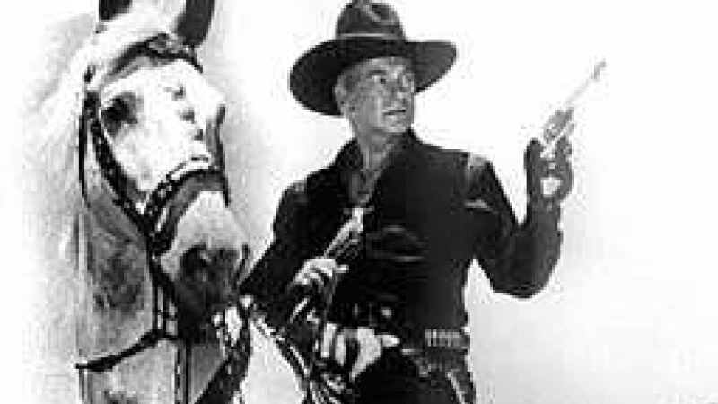 Photo of Hopalong Cassidy played by William Boyd sitting on a horse