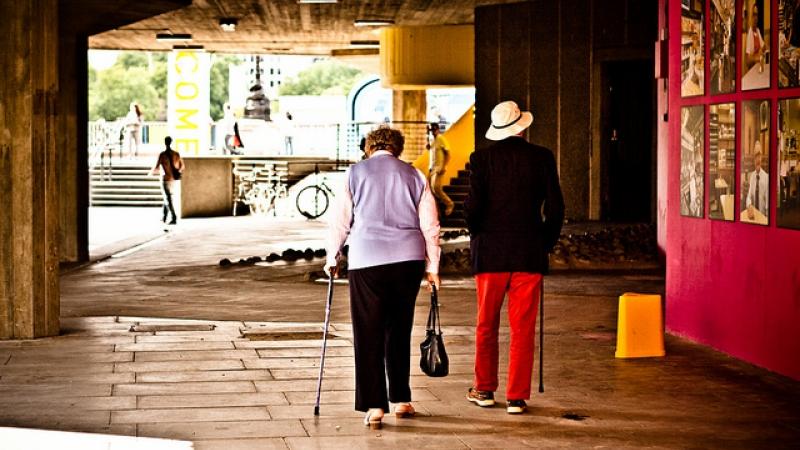 Two older adults walker