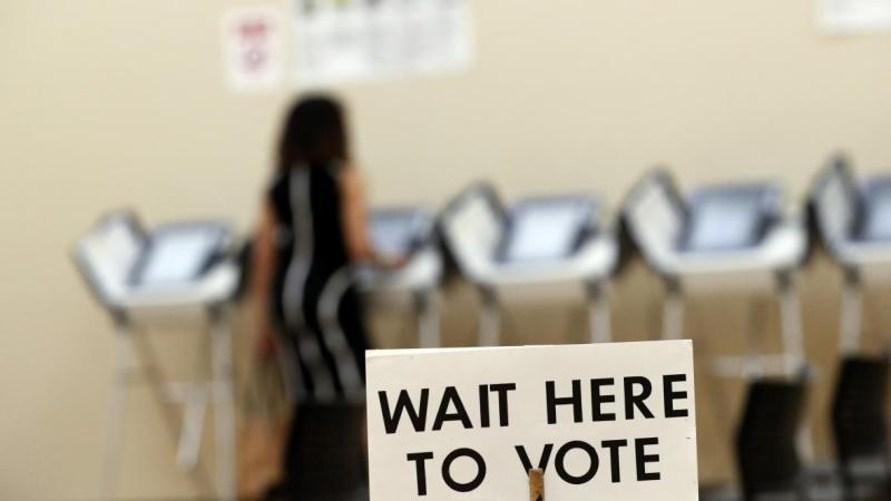 Wait here to vote sign