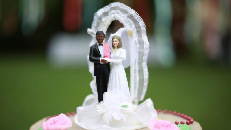 plastic couple on wedding cake