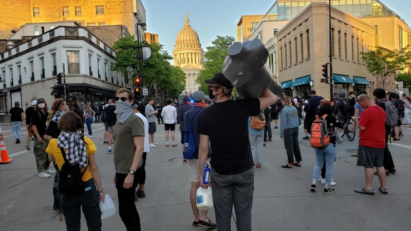 Protesters on State Street in downtown Madison early Saturday evening.