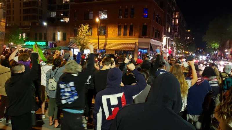 Protesters face off against police Saturday night in downtown Madison.