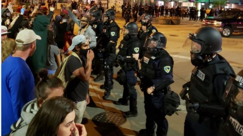 Protesters face off against police near State Street in downtown Madison on Saturday night.