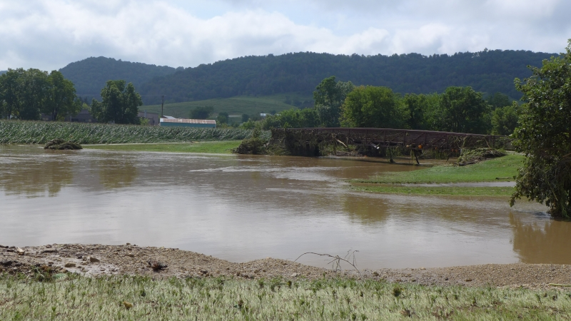 A flooded Coon Creek overflows onto Coon Valley Veterans Memorial Park