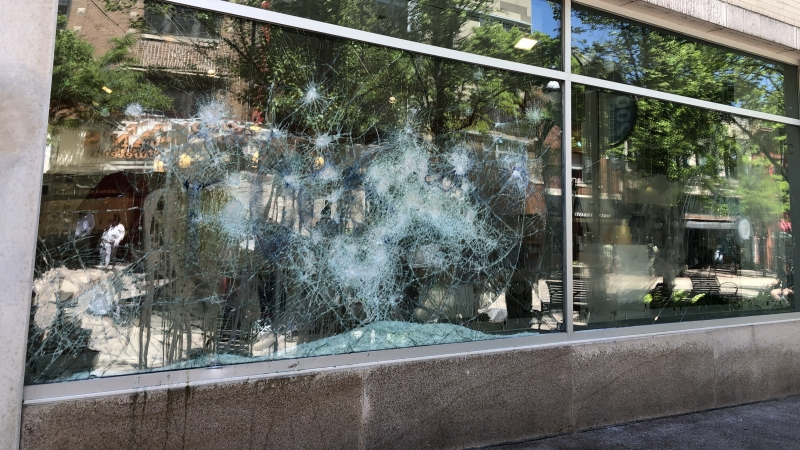 a smashed window on State Street in Madison