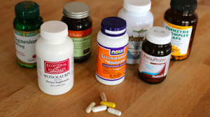 A variety of probiotic supplements sit on a counter.