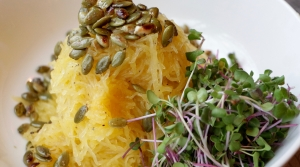 Spaghetti Squash and microgreens with toasted pumpkin seeds on top.