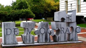 Democracy spelled out in granite puzzle pieces