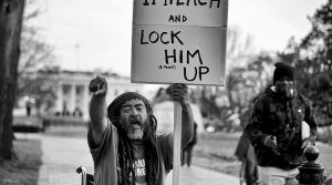 A protester calling for Trump's imprisonment