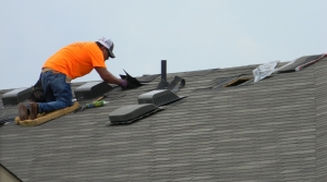 roofer fixing shingles