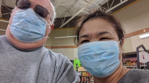 Two people shopping with masks on.