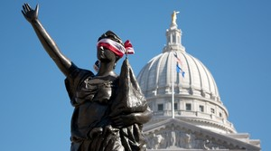 Blindfolded statue in front of Wisconsin Capitol