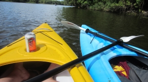 front of two kayaks in water