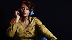 Woman with headphones.