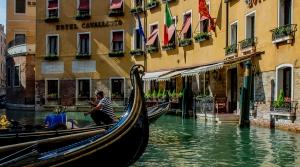 Gondolier aboard a gondola in Venice, Italy